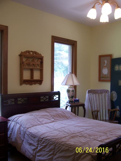 Bedroom #1 - Full size bed Sleeps 2 with rocking chair & country view