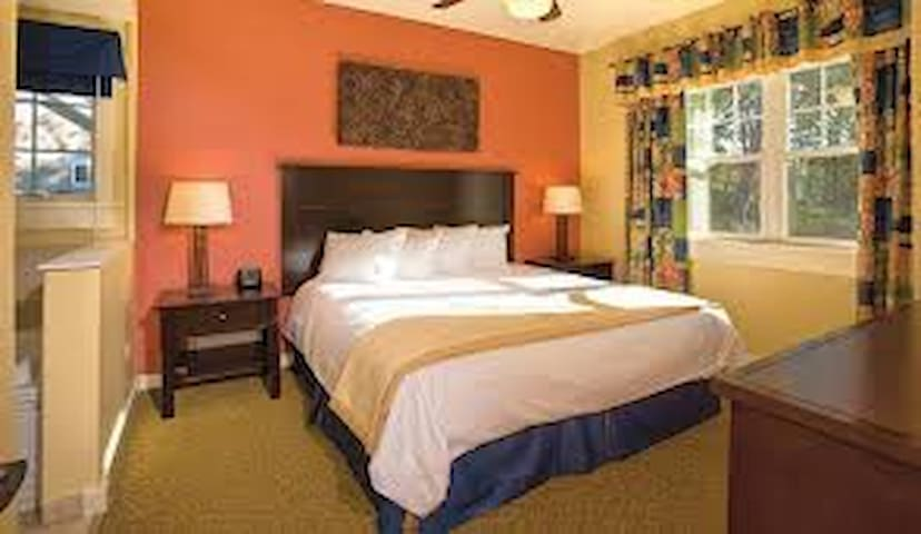The luxury master bedroom offers a comfy king bed