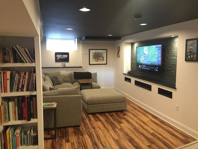 Finished basement with 9 foot ceiling - a rarity in this neighborhood  - features built-in  Vizio TV with apps and enormous comfy sectional couch (not for sleeping). This is the other gem of our home.