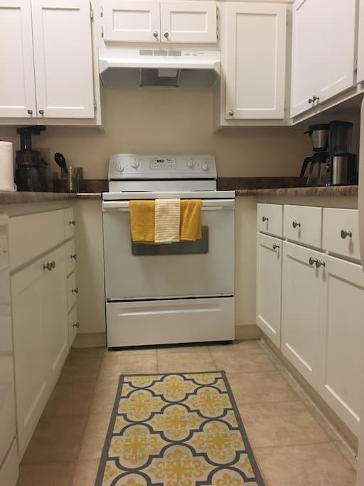 Kitchen includes stove, oven, masticating juicer, ninja blender/food processor, Ninja Coffee Maker