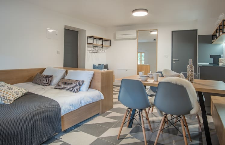 Cosy bed for two and dining table next to it