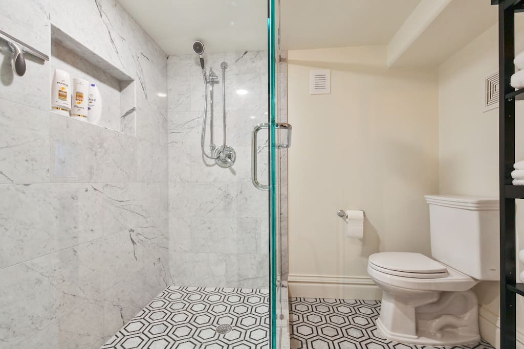 Pamper yourself in our luxurious marble-clad bathroom with a huge walk in shower.