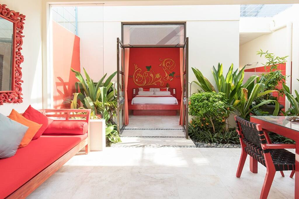 Poolside Garden Suite with semi-open living area in private garden.