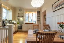 Dining area with space up to 4 people. Different kind of kitchenware available.
