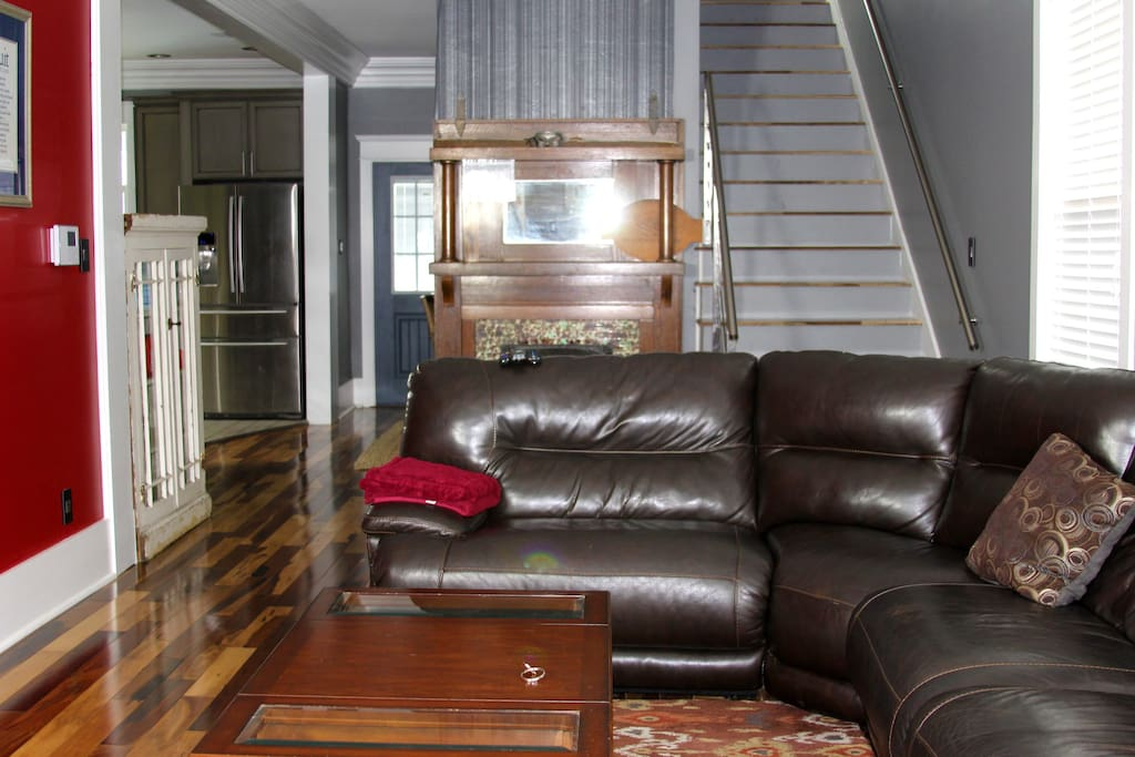"""living room with 50"""" tv and leather sofa"""