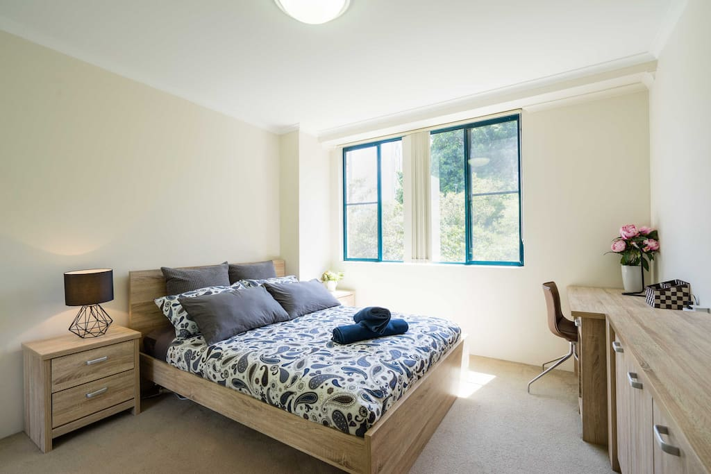 Master bedroom with queen size bed and study desk