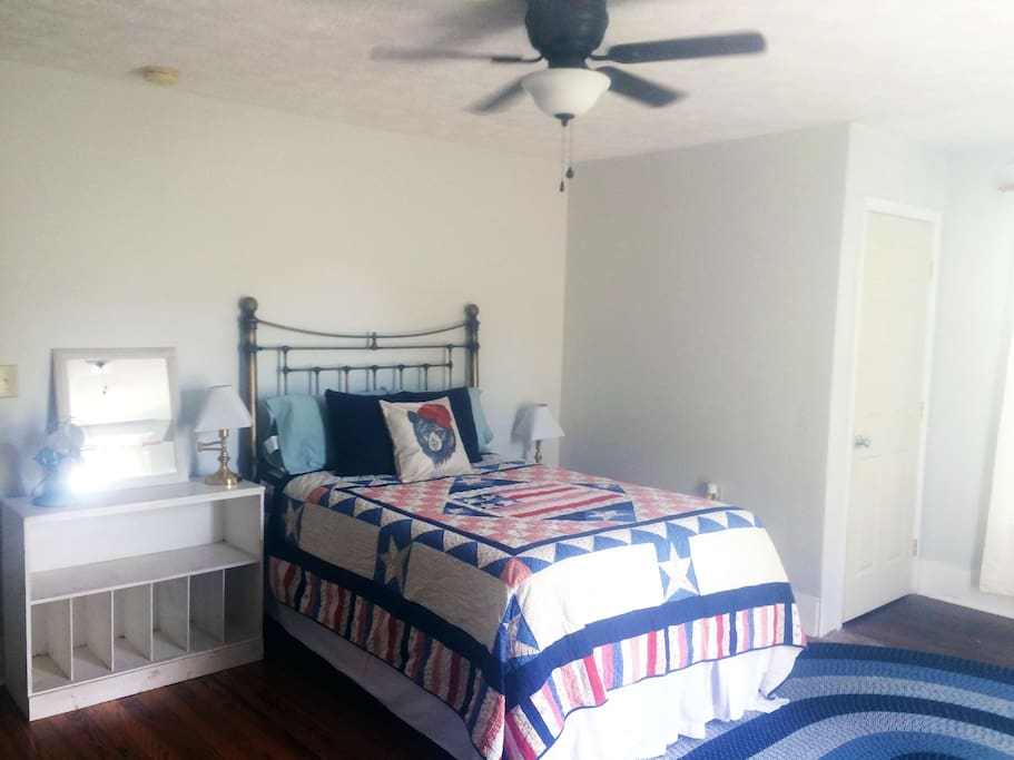Their is plenty of space for two people and a large closet and lots of dresser space. The fan is great for warmer summer nights.