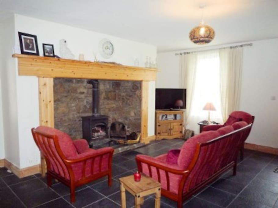 First living room, stove & entertainment centre
