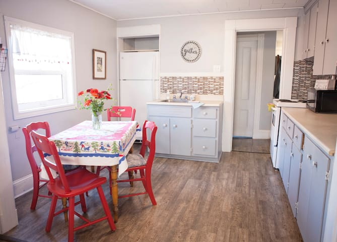 The kitchen is open to the living area. Has everything needed to prepare meals or walking distance to many dine in or take out restaurants.