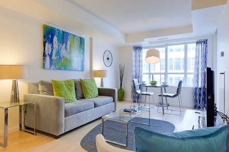Unbeatable location: Financial & Entertainment Districts, public transit only steps away. This cosy, stylishly furnished 2 bed, 1 bath condo comfortably sleeps 3 & will permit you to explore downtown Toronto with ease.  Minimum stay is 30 days.