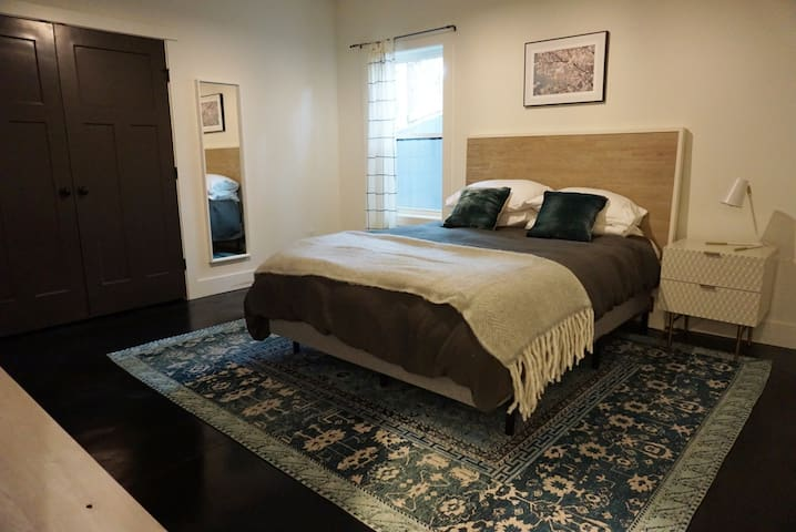 Bedroom 3 on the terrace level with queen bed- the most spacious bedroom in the house...