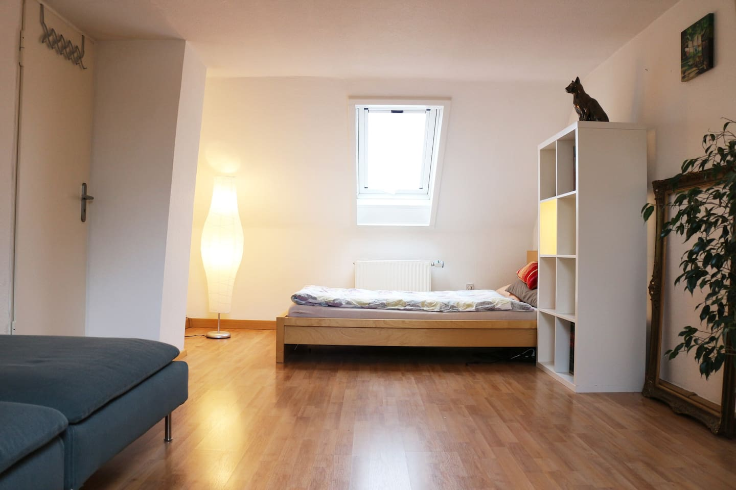 Cozy Loft Room with one double bed and one sofa, which can be used as bed aswell