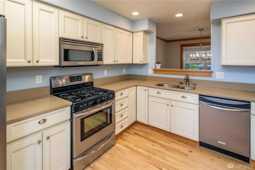 The kitchen is fully equipped and has all stainless appliances.