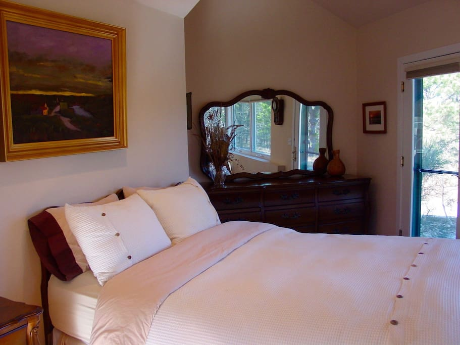 The master bedroom's cherrywood queen.
