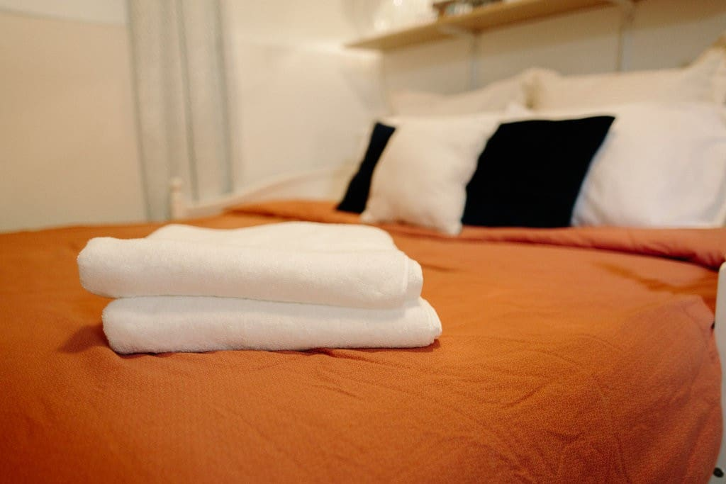 Large California King Bed with towels for your stay.