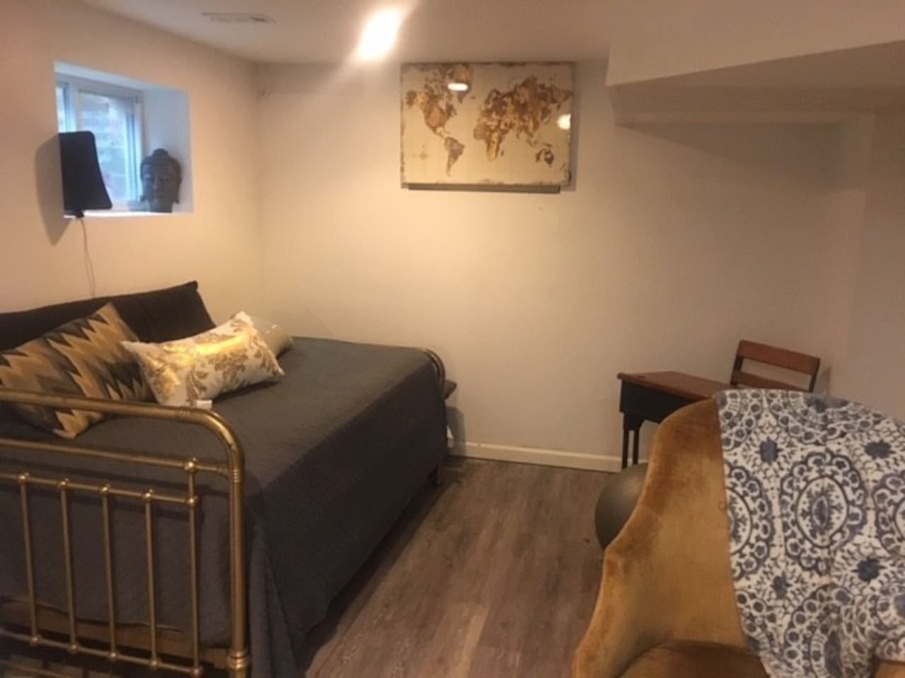 Comfy elongated twin bed in lower level alcove adjacent to full comfy couch