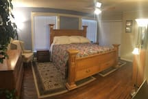 Master Bedroom with King-size bed.  Two closets.  Hardwood Floors.  Large Flat Screen TV.