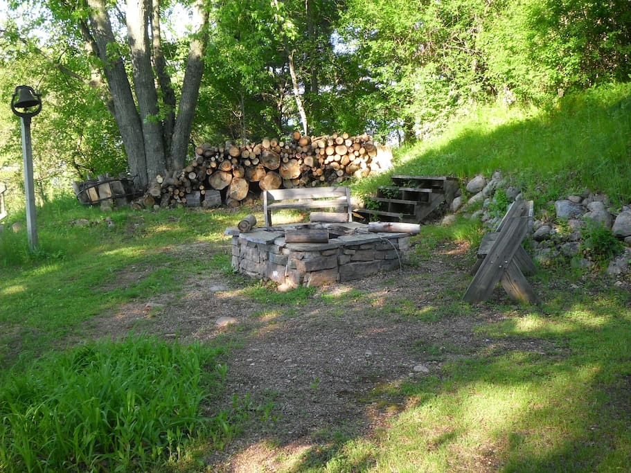 Out side fire place with wood provided.