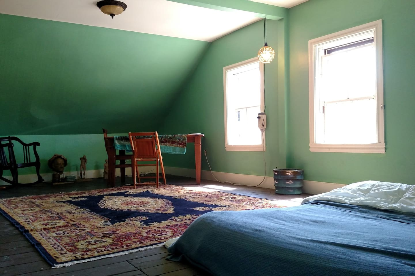 very spacious, sunny and private, the green room is a cozy spot to enjoy Providence from.