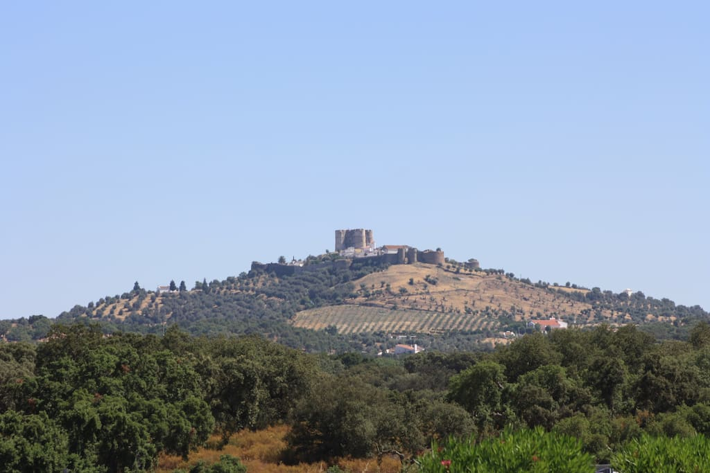 The hill, the walled Castle on top, we are next to the Castle