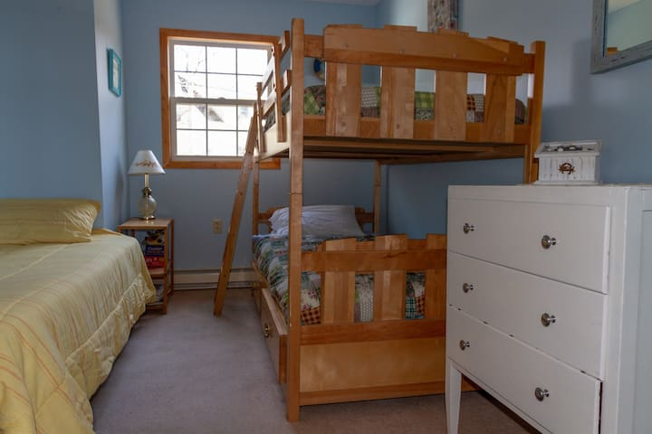 One bedroom with twin bed, and bunk bed