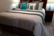 Welcoming bedroom with new comfy king size bed and luxurious linens. In room TV.