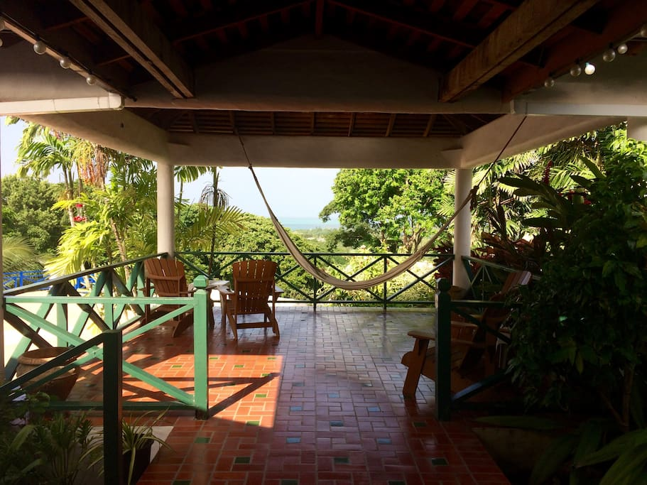 Elevated porch area with views over Buccoo Reef and the Caribbean Sea.