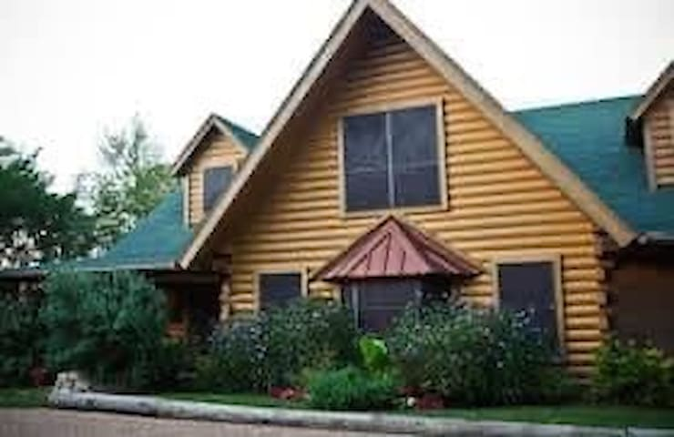 LOG  LODGE  BED and BREAKFAST on BRAZOS  River
