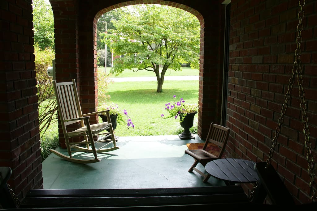 A summertime view from our porch swing. Feel free to take advantage of this peaceful space whenever you like.
