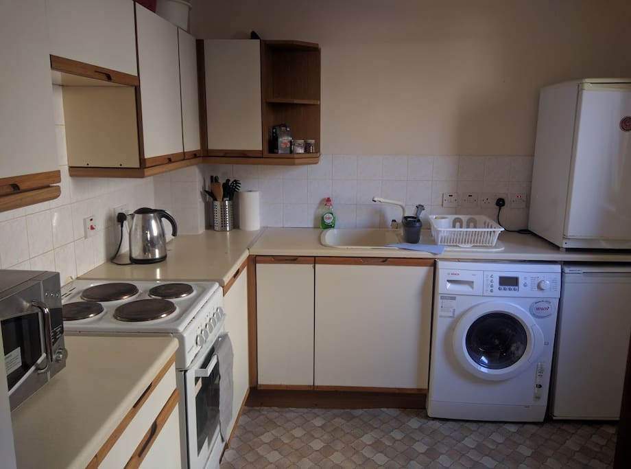 Well appointed kitchen with cooker, microwave, fridge, freezer, kettle, toaster and washer-drier