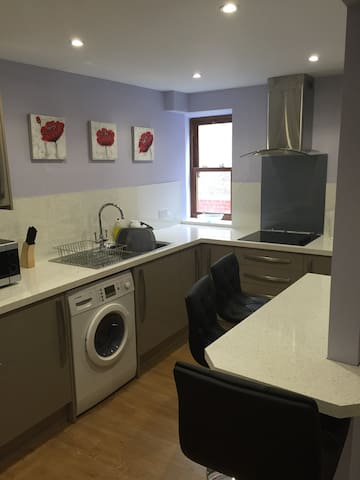 The kitchen has a hob, oven, microwave, washing machine and plenty crockery and kitchen ware.