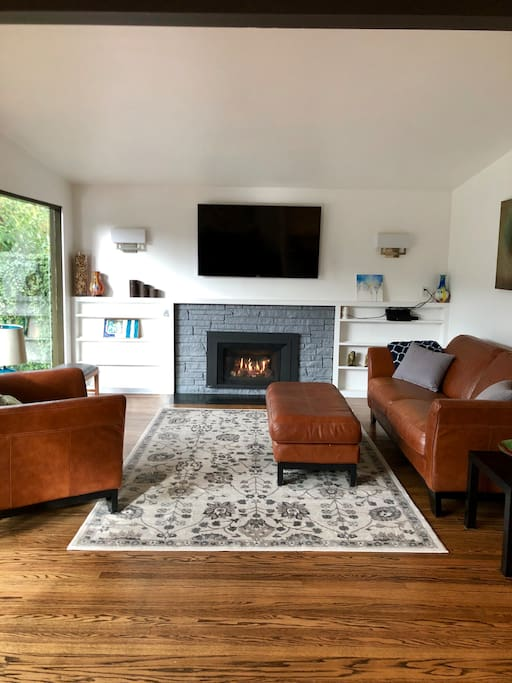 Living room on main floor with gas fireplace.  Floor to ceiling windows with sliding doors that lead to the back deck.  Lots of natural light.