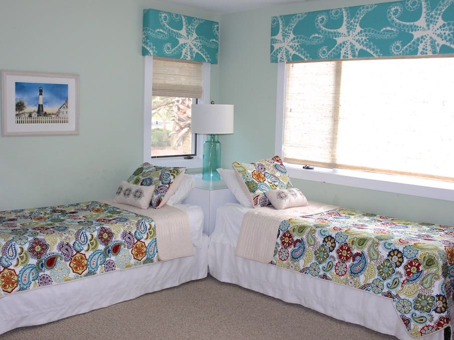 There are two bedrooms on this level. the 1st bedroom has two twin beds