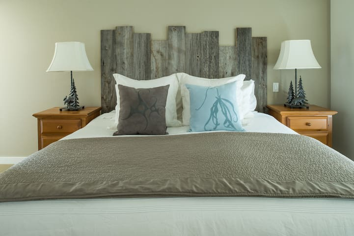 Comfortable king bed with luxury linens in Master Bedroom.