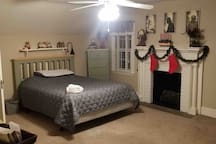 queen size bed with dressers, closet and extra storage