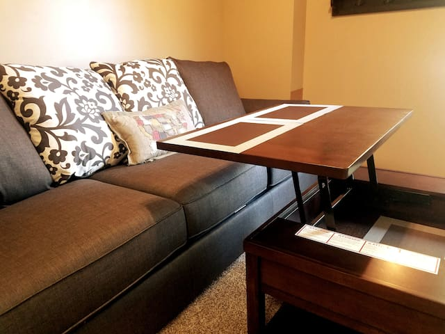 Coffee table also converts into a desk or dining table. Please use placemats or serving trays.