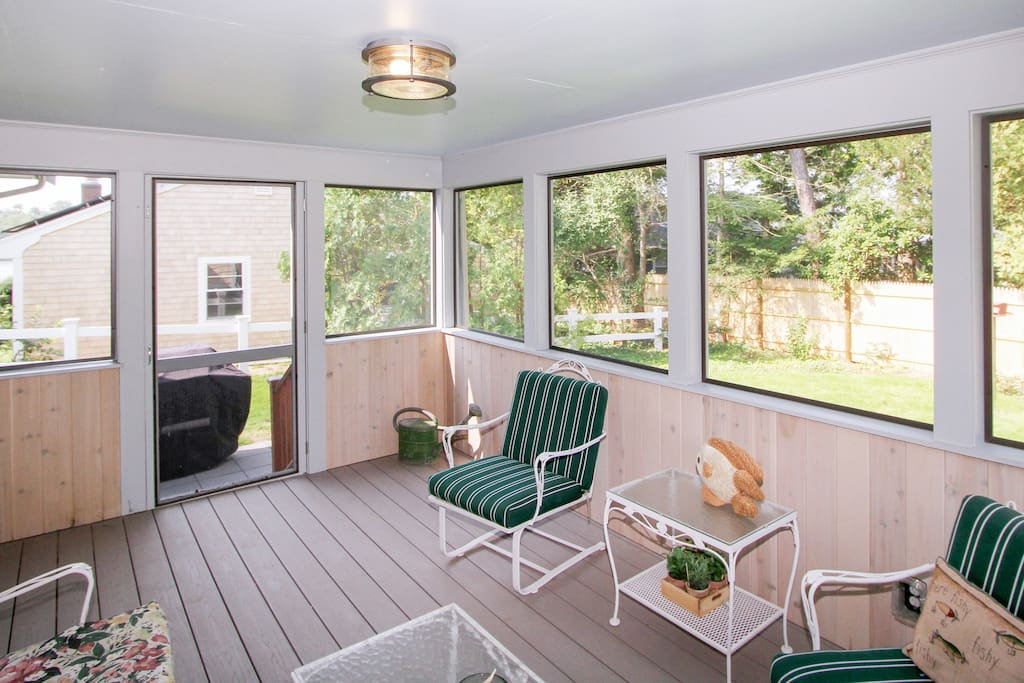 There's plenty of seating on the screened porch.