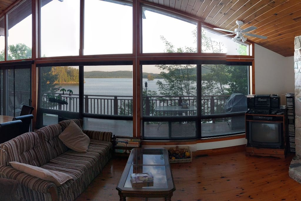 The front of the cottage is a full wall of windows, given you full view of the water and hills.