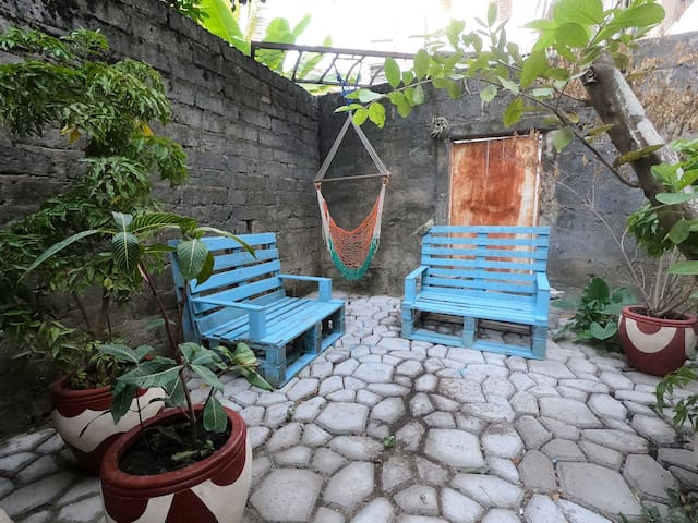 Our small garden gives you a change to spend time outside, in a secluded environment.