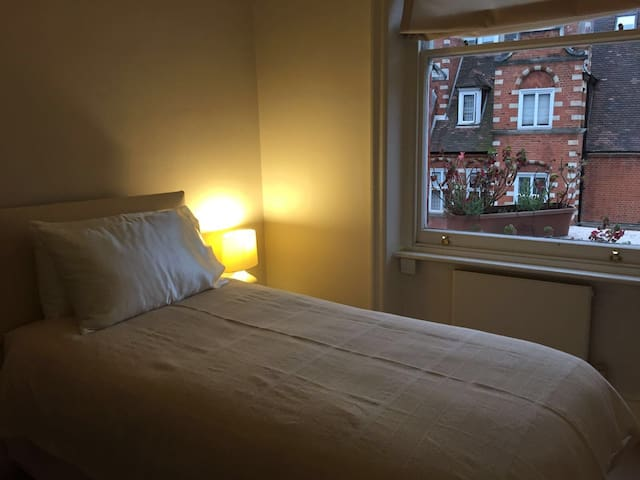 2nd bedroom with view of Collingham Gardens
