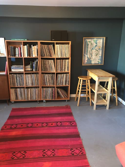 Record den living space. Perfect for record listening and movie watching after a long hike or day at the museum. Queen sized futon can be made up to host additional guests.