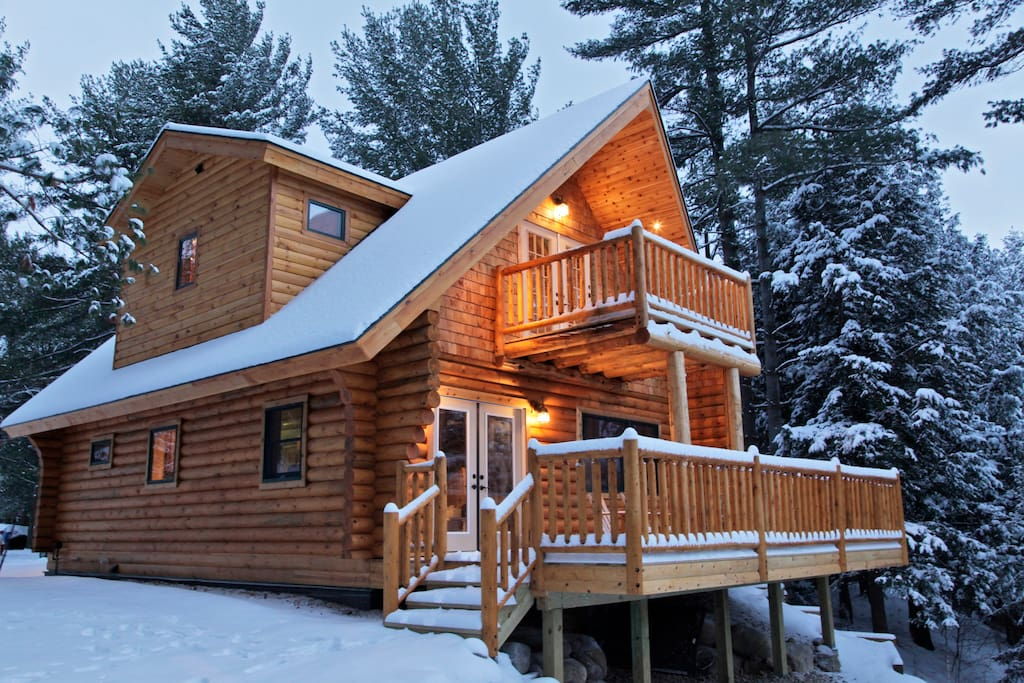 inviting Adirondack log home with gas fireplace for cozy winter evenings after skiing nearby