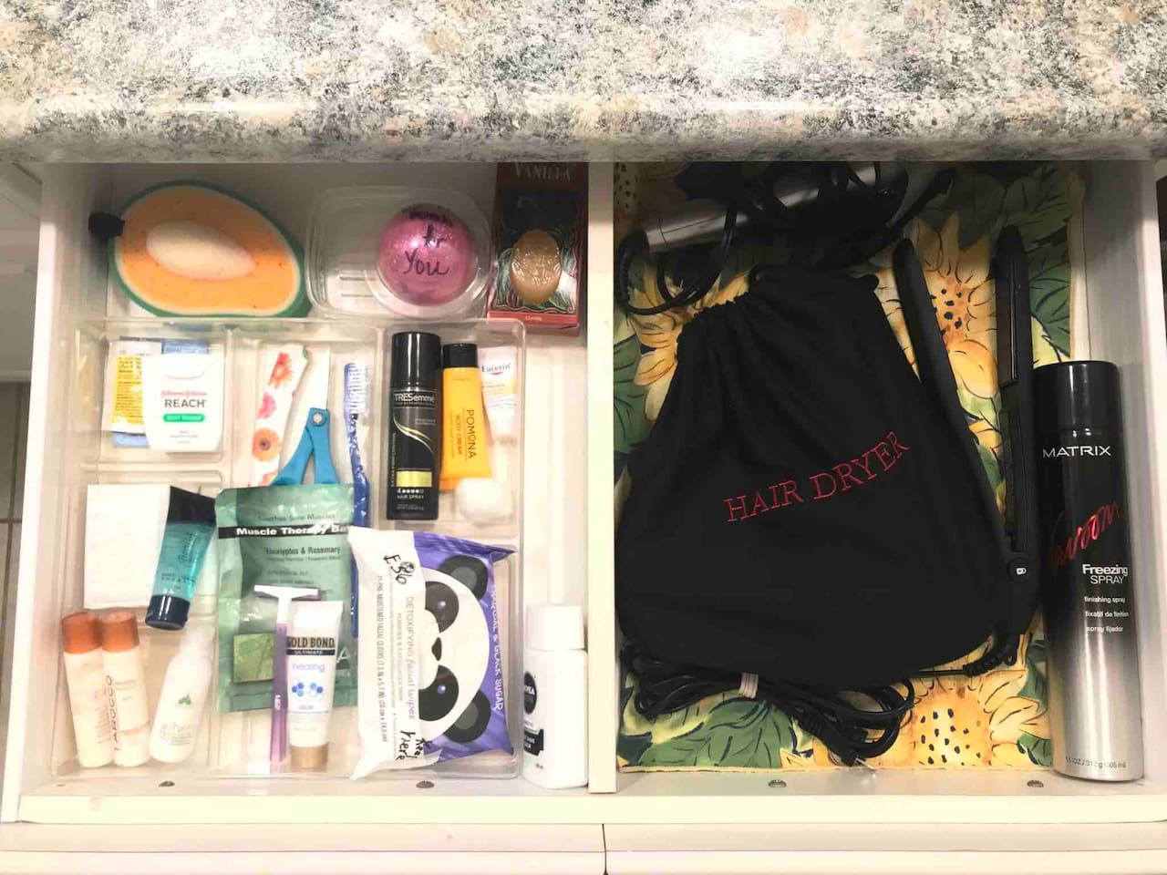 Plenty of miscellaneous supplies you might need in each bathroom. Help yourself!  Plus each bathroom has a nice hairdryer and various styling tools + hairspray.