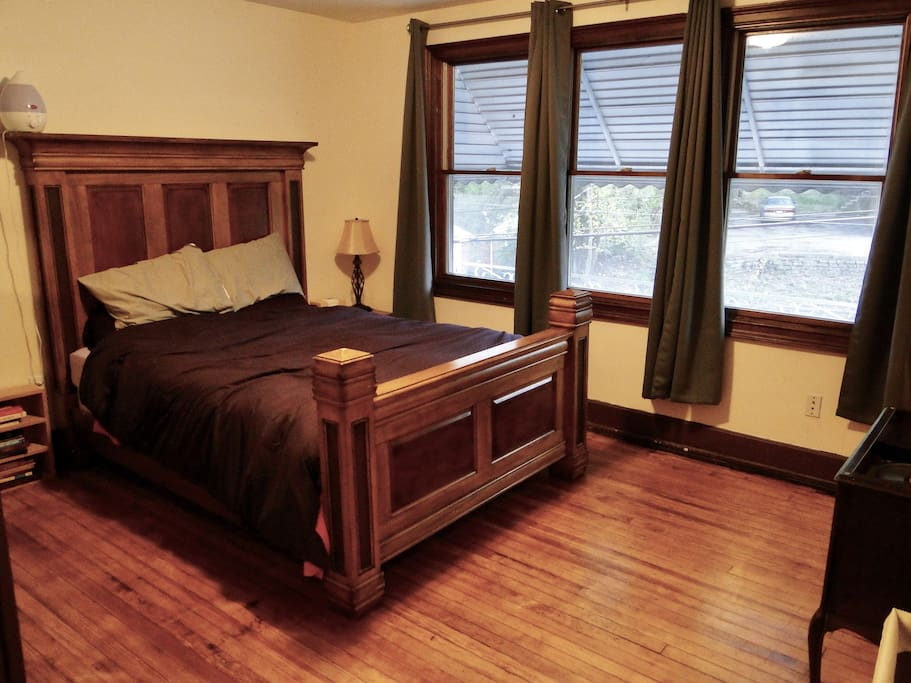 That's your queen sized memory foam mattress bed there with a matching dresser and a closet to the side. This bedroom has hardwood floors.