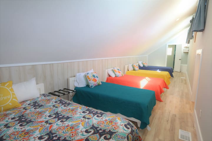 Kids adore this upper-level room with kid-sized doorway, 4 twins & 1 Queen bed
