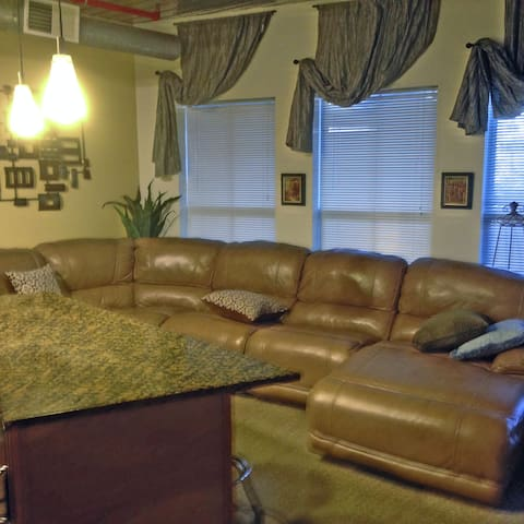 This is another shot of the over-sized recliner couch. Three of the seats recline. The windows look out on the front patio.