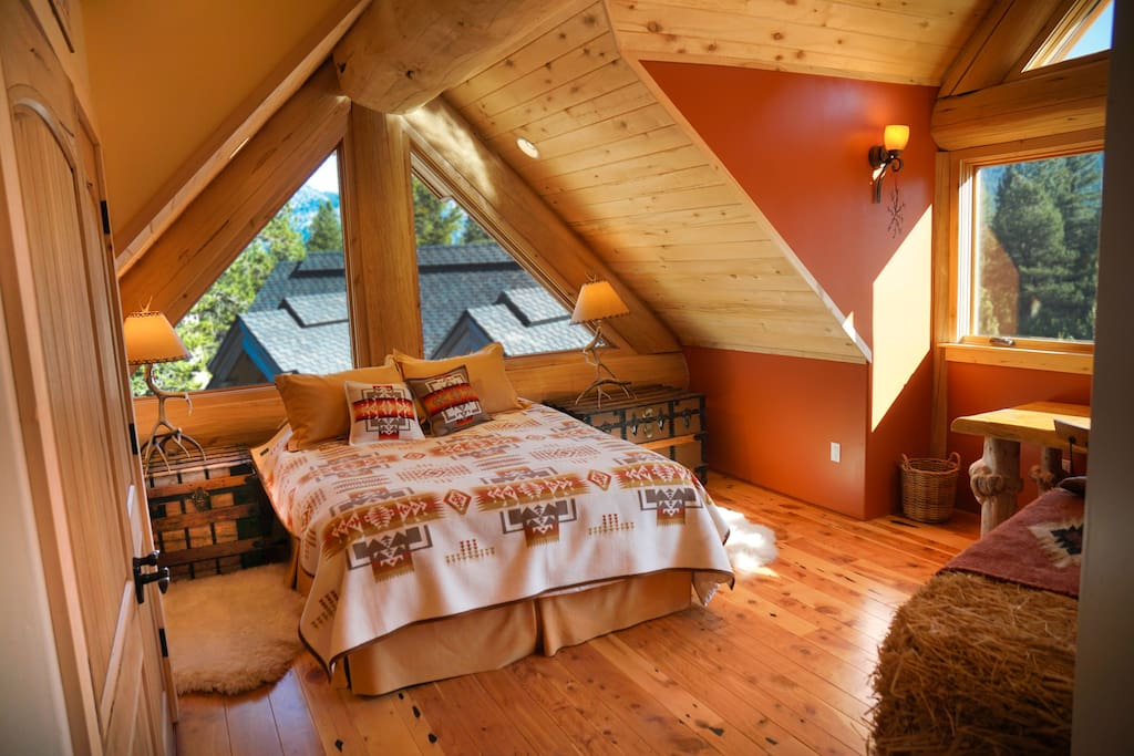 Cowboy Room is a cheery spacious room with comfy queen bed, and large bathroom shared with one other guest room.