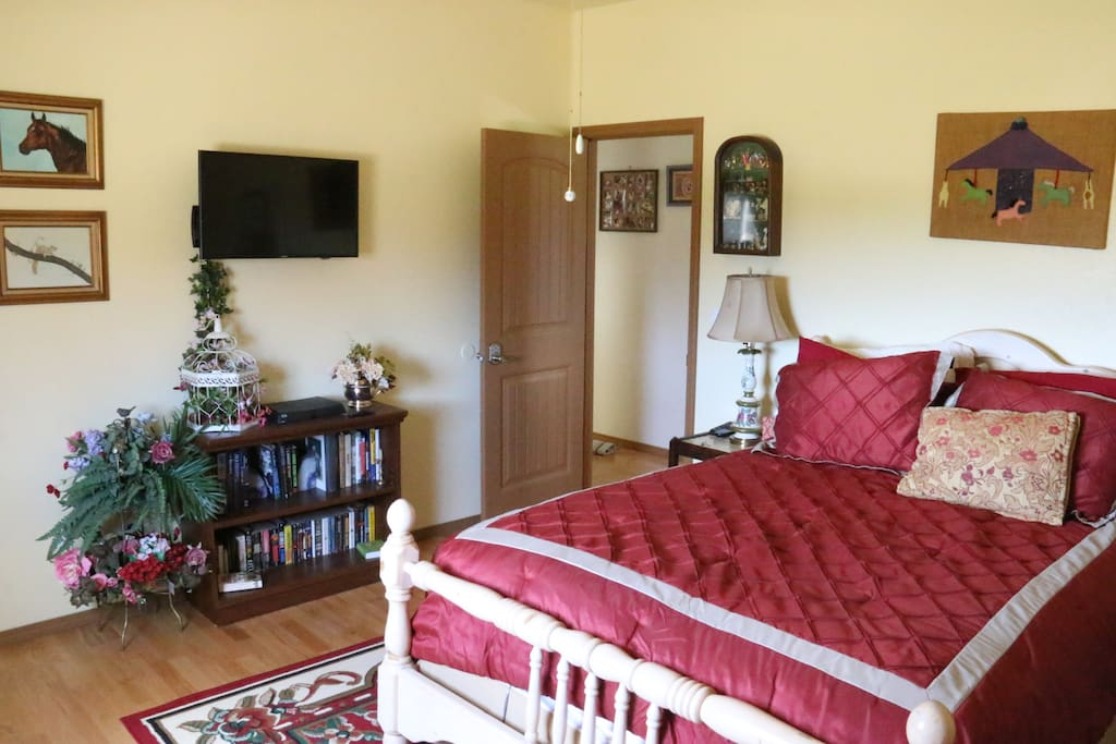 The English room has a writing desk, smart tv with satellite, recliner and wonderful pillowtop bed.