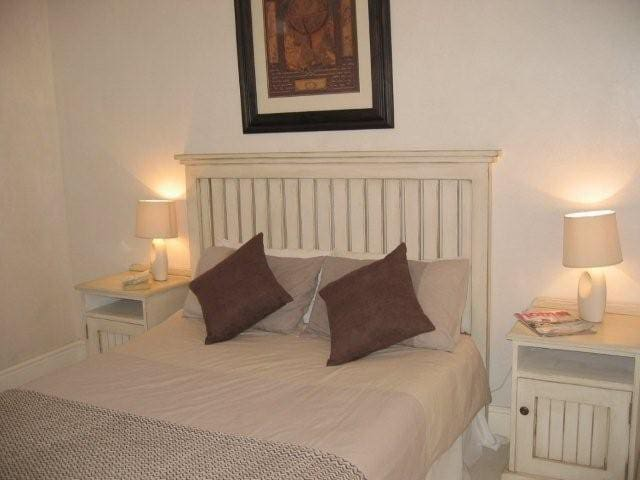 The main bedroom offers a double bed and has a door which leads on to the patio.  The en suite bathroom has a shower