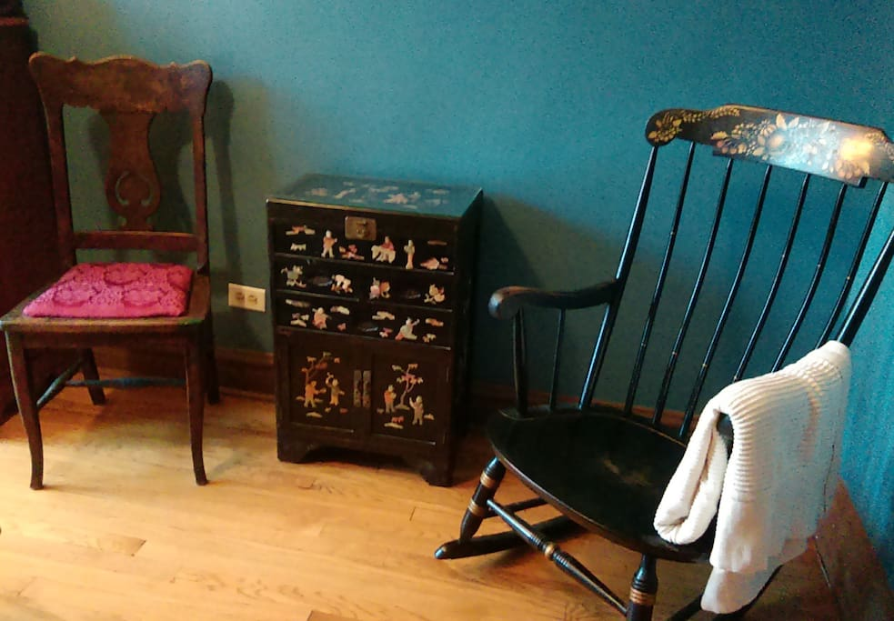 Two chairs for sitting. . . or stashing stuff. The rocking chair and chest have been in Gin's family a long time.